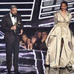 Drake presents Rihanna with the Video Vanguard Award at the 2016 VMAs.