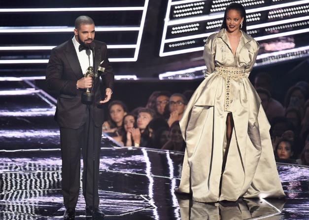 Drake presents Rihanna with the Video Vanguard Award at the 2016 VMAs.